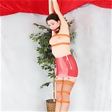 Milf in Stockings gagged and suspended from the ceiling.